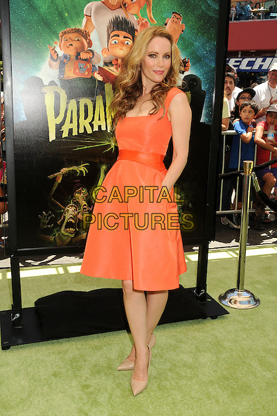"Leslie Mann.""ParaNorman"" Los Angeles Premiere held at AMC CityWalk Stadium 19 Theatre, Universal City, California, USA..August 5th, 2012.full length shoes beige dress orange hand in pocket waistband .CAP/ADM/BP.©Byron Purvis/AdMedia/Capital Pictures."