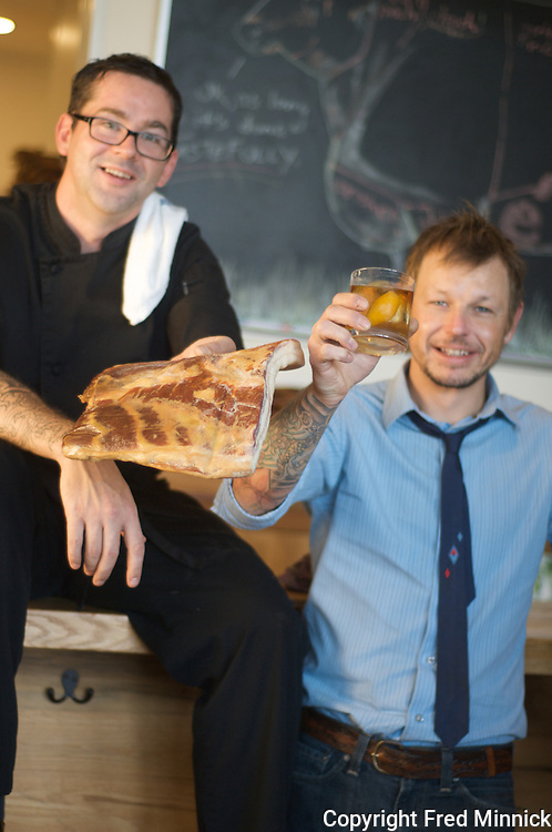 Mixologist Larry Rice, who actually prefers to be called bartender, and Chef Jayson Lewellyn (black shirt) own and operate the popular Louisville restaurant 732 Social.