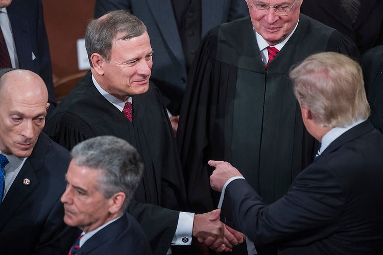 UNITED STATES - FEBRUARY 28: President Donald Trump greets Chief Justice John Roberts after addressing a joint session of Congress in the Capitol's House Chamber, February 28, 2017. (Photo By Tom Williams/CQ Roll Call)