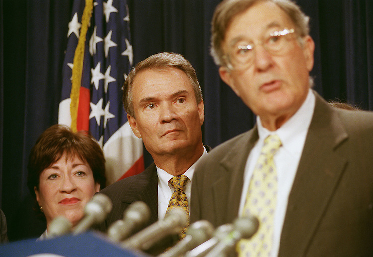 7/28/99.BIPARTISAN TAX CUT ALTERNATIVE--Sens. Susan Collins, R-Maine, and John Breaux, D-La., listen to John Chafee, R-R.I., during a news conference on a bipartisan tax cut proposal..CONGRESSIONAL QUARTERLY PHOTO BY SCOTT J. FERRELL