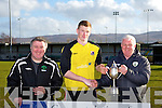 Dingle Captain Tomas  Mcateer receives the cup from John Regan with Denis Guerin at the Celsius Menswear Final in Mounthawk Park Dingle V Tralee Athletic on Sunday