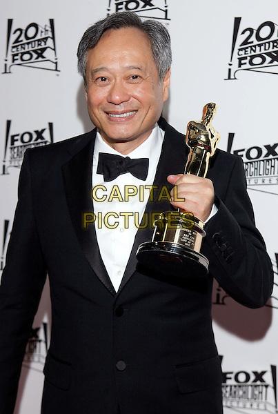 Ang Lee.2013 Twentieth Century Fox & Fox Searchlight Pictures Oscar Party held at  Lure, Hollywood, California, USA..February 24th, 2013.oscars half length black tuxedo trophy award winner.CAP/ADM/DAN.©Dan Scott/AdMedia/Capital Pictures.