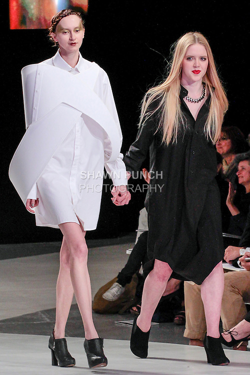 Graduating fashion student Simone Kurland, walks runway with model at the close of the 2013 Pratt Institute Fashion Show, on April 25, 2013.