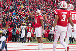 Wisconsin Badgers wide receiver A.J. Taylor (4) celebrates a touchdown pass during an NCAA College Big Ten Conference football game against the Michigan Wolverines Saturday, November 18, 2017, in Madison, Wis. The Badgers won 24-10. (Photo by David Stluka)