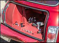 BNPS.co.uk (01202 558833)<br /> Pic: Silverstone/BNPS<br /> <br /> The tiny boot has been converted into a bar area.<br /> <br /> A 'funky' Mini Cooper that comes complete with its own disco ball and drinks bar is to be sold at auction by Jamiroquai singer Jay Kay.<br /> <br /> Affectionately nicknamed 'Chuckles' by the star, the Cooper Sport has been given a complete overhaul and is now completely unique.<br /> <br /> It has been fitted with plush velvet curtains and a bespoke red leather interior to go with a multicoloured disco light located on the cabin ceiling.