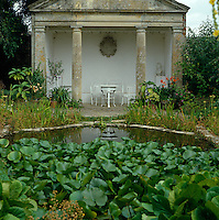 A pond filled with water lilies creates the perfect setting for a neo-classical folly