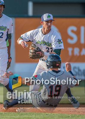 31 July 2016: Vermont Lake Monsters infielder Eli White get a sliding Daniel Woodrow out at second, then turning a double play in the 7th inning against the Connecticut Tigers at Centennial Field in Burlington, Vermont. The Lake Monsters edged out the Tigers 4-3 in NY Penn League action.  Mandatory Credit: Ed Wolfstein Photo *** RAW (NEF) Image File Available ***