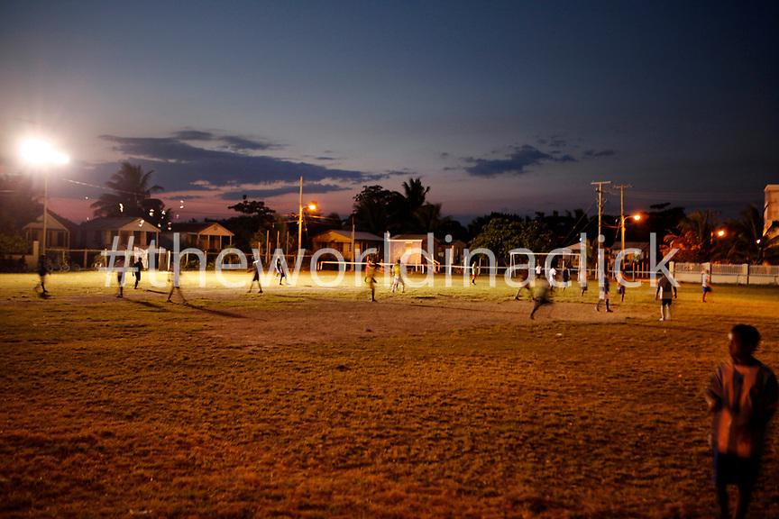 BELIZE, Caye Caulker, an evening game of soccer