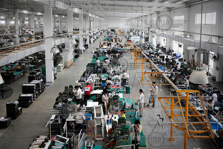 Workers assemble baby buggies at a Goodbaby factory in Kunshan. Goodbaby is China's largest manufacturer and supplier of infant's and children's products