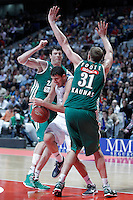 Real Madrid's Nikola Mirotic (c) and Zalgiris Kaunas' Ksistof Lavrinovic (l) and Jeff Foote (r) during Euroleague 2012/2013 match.January 11,2013. (ALTERPHOTOS/Acero) NortePHOTO