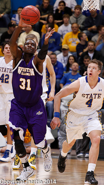 SIOUX FALLS, SD - MARCH 9:  Garret Covington #31 of Western Illinois chases down a loose ball with Jake Bittle #4 of South Dakota State close behind during their first round game at the 2014 Summit League Basketball Championships Sunday at the Sioux Falls Arena.  (Photo by Dick Carlson/Inertia)