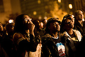 Rosamond Bankole, 25, of Durham, center, and Jenny Ingabire, 22, right, watch Barack Obama give his acceptance speech during the Barack N? Roll Celebration return watch party in downtown Durham,  Tues., Nov. 4, 2008..