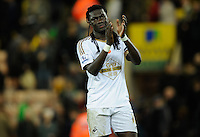 Bafetimbi Gomis of Swansea City applauds the fans at full-time during the Barclays Premier League match between Norwich City and Swansea City played at Carrow Road, Norwich on November 7th 2015