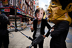 JUNE 28, 2019 - Demonstrators wearing masks of German Chancellor Angela Merkel and Japanese Prime Minister Shinzo Abe talk to the media at a protest against coal power during the G20 Summit in Osaka, Japan. (Photo by Ben Weller/AFLO) (JAPAN) [UHU]