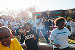 A.J. Johnson, a Spelman alum and fitness trainer, leads a crowd in a stretch and warm-up before the first annual Wellness Revolution 5K Run and Walk on the Spelman College campus in Atlanta, Georgia April 6, 2013.