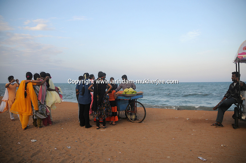 Indian tourists at the beach of Pondicherry.