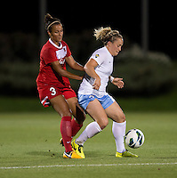 Kika Toulouse (3) of the Washington Spirit tries to stay close to Ella Masar (3) of the Chicago Red Stars during the game at the Maryland SoccerPlex in Boyds, Md.   Chicago defeated Washington, 2-0.