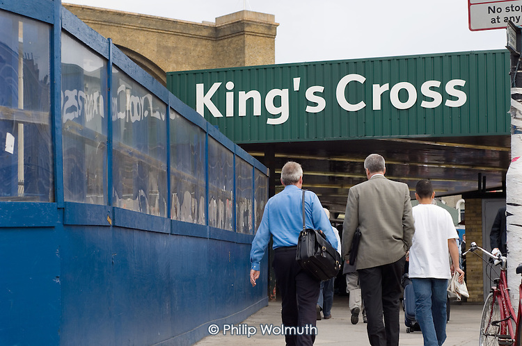 Travellers arrive at Kings Cross station in central London.