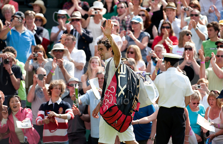 Roger Federer (SUI) celebrates after the match against Alejandro Falla (COL)- The Wimbledon Championships 2010 The All England Lawn Tennis & Croquet Club  Day 1 Monday 21/06/2010