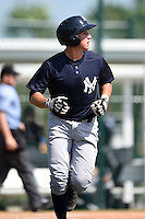 Catcher Radley Haddad (11) of the New York Yankees organization during a minor league spring training game against the Pittsburgh Pirates on March 22, 2014 at Pirate City in Bradenton, Florida.  (Mike Janes/Four Seam Images)