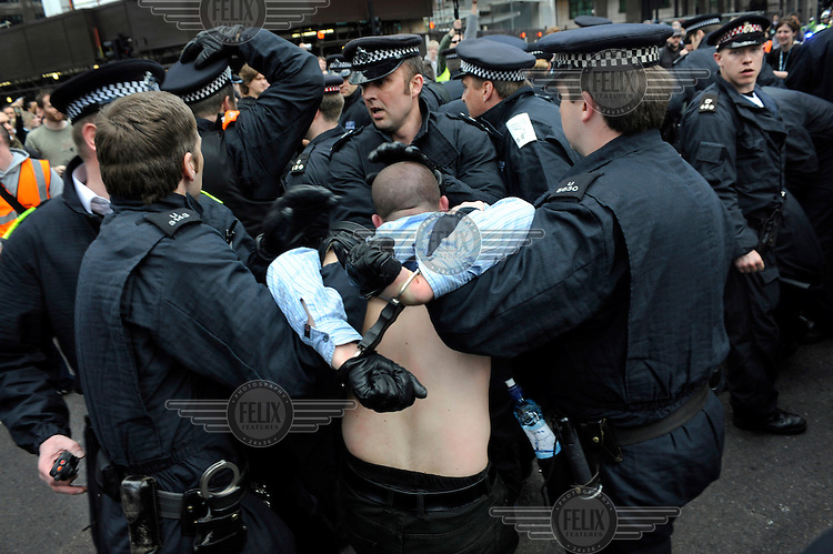 Police arrest activists at the Climate Camp as thousands of protestors descended on the City of London ahead of the G20 summit of world leaders to express anger at the economic crisis, which many blame on the excesses of capitalism.