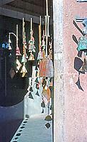 Paolo Soleri: ARCOSANTI. Bronze Bells in doorway. Photo '76.
