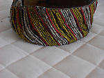 DAYAK IBAN BEDED HEADBAND WITH PALM LEAF IN THE PANEL TO STIFFEN THE BAND.