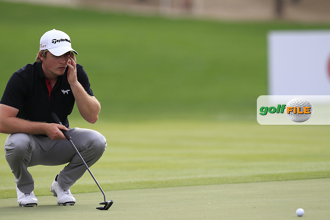 Eddie Pepperell (ENG) on the 17th green during Sunday's Final Round of the Abu Dhabi HSBC Golf Championship 2015 held at the Abu Dhabi Golf Course, United Arab Emirates. 18th January 2015.<br /> Picture: Eoin Clarke www.golffile.ie