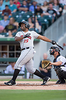 Jason Rogers (15) of the Indianapolis Indians follows through on his swing against the Charlotte Knights at BB&T BallPark on June 16, 2017 in Charlotte, North Carolina.  The Knights defeated the Indians 12-4.  (Brian Westerholt/Four Seam Images)