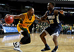 SIOUX FALLS, SD - MARCH 8: Vinnie Shahid #0 of the North Dakota State Bison controls his dribble while being guarded by R.J. Fuqua #12 of the Oral Roberts Golden Eagles at the 2020 Summit League Basketball Championship in Sioux Falls, SD. (Photo by Dave Eggen/Inertia)