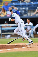 Asheville Tourists Will Golson (8) swings at a pitch during a game against the Lakewood BlueClaws at McCormick Field on August 4, 2019 in Asheville, North Carolina. The Tourists defeated the BlueClaws 13-6. (Tony Farlow/Four Seam Images)