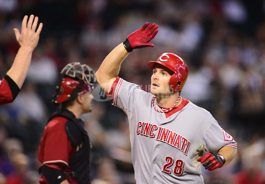 Aug. 29, 2012; Phoenix, AZ, USA: Cincinnati Reds outfielder Chris Heisey celebrates with teammates after hitting a two run home run in the seventh inning against the Arizona Diamondbacks at Chase Field. Mandatory Credit: Mark J. Rebilas-