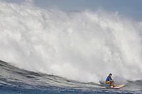 Shane Desmond rides a wave during the Mavericks Surf Contest in Half Moon Bay, Calif., Saturday, January 12, 2008.