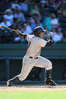 Third baseman Isaias Tejeda (19) of the Charleston RiverDogs bats in a game against the Greenville Drive on Sunday, June 28, 2015, at Fluor Field at the West End in Greenville, South Carolina. Charleston won, 12-9. (Tom Priddy/Four Seam Images)
