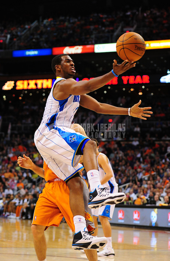 Mar. 25, 2011; Phoenix, AZ, USA; New Orleans Hornets guard (3) Chris Paul against the Phoenix Suns at the US Airways Center. The Hornets defeated the Suns 106-100. Mandatory Credit: Mark J. Rebilas-