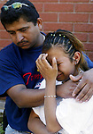 (MURDER)--On Mon Sept. 9,2002-murder0909C-METRO-a relative (left) comforts Araceli Cruz, age 17 the daughter of a murder victim  Refugia Ruiz Olmedo at 192 French St, New Brunswick after the woman was murdered and her body dumped in the woods in South Brunswick.(MARK R. SULLIVAN/HNT CHIEF PHOTOGRAPHER)
