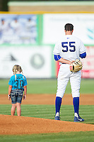 A young fan stands next to Burlington Royals starting pitcher Foster Griffin (55) during the National Anthem prior to the game against the Greeneville Astros at Burlington Athletic Park on June 29, 2014 in Burlington, North Carolina.  The Royals defeated the Astros 11-0. (Brian Westerholt/Four Seam Images)