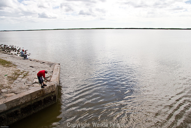 The Chokoloskee Bay bridge from Everglades City to Chokoloskee  is a favorite spot for net casters.