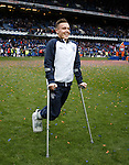 Barrie McKay joining in the celebrations on his crutches