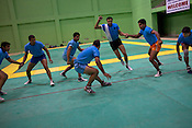 The defendant team attempts to stay away from the raider while he tries to touch him during the kabbadi training sessions as part of the training at a month long camp for the Indian national Kabbadi team in Sport Authority of India Sports Complex in Bisankhedi, outskirts of Bhopal, Madhya Pradesh, India.