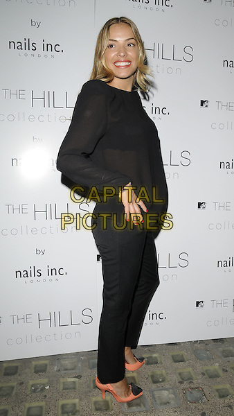 ELEN RIVAS .The Hills Collection launch party, Nails Inc. shop, South Molton St., London, England..full length black top sheer see through thru bra side trousers pink coral peach peep toe shoes heart hands on hips shoulder pads nail varnish polish .CAP/CAN.©Can Nguyen/Capital Pictures.