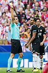 Referee Juan Martinez Munuera (l) shows the yellow card to Gabriel Ivan Mercado of Sevilla FC during the La Liga 2017-18 match between Atletico de Madrid and Sevilla FC at the Wanda Metropolitano on 23 September 2017 in Madrid, Spain. Photo by Diego Gonzalez / Power Sport Images