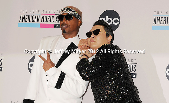 LOS ANGELES, CA - NOVEMBER 18: Hammer and Psy pose in the press room at the 40th Anniversary American Music Awards held at Nokia Theatre L.A. Live on November 18, 2012 in Los Angeles, California.