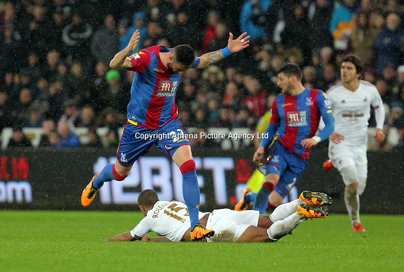 Wayne Routledge of Swansea on the ground, is fouled by Damien Delaney of Crystal Palace during the Barclays Premier League match between Swansea City and Crystal Palace at the Liberty Stadium, Swansea on February 06 2016