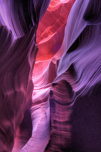 The colorful fluted walls of Lower Antelope Canyon formed through millions of years of erosion.