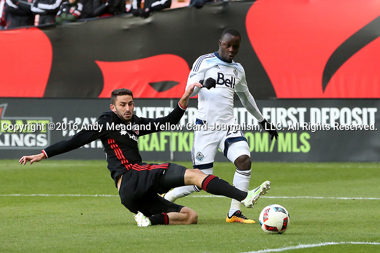 09 April 2016: Vancouver's Kekuta Manneh (GAM) (right) cross the ball past DC United's Steve Birnbaum (left). DC United hosted the Vancouver Whitecaps FC at RFK Stadium in Washington, DC in a 2016 Major League Soccer regular season game. DC United won the match 4-0.