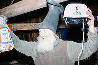 Satirical presidential candidate Vermin Supreme unpacks a toaster as he arrives at Ten Rod Farm for a campaign event in Rochester, New Hampshire. The toaster burns his image on to pieces of bread. Supreme's platform advocates a pony-based economy, using zombies to solve the energy crisis, and other outlandish ideas. Supreme has been on the New Hampshire primary ballot in 2008 and 2012, though he began running for president in 1992. Vermin Supreme will be on the Democratic party ballot in the 2016 New Hampshire primary.