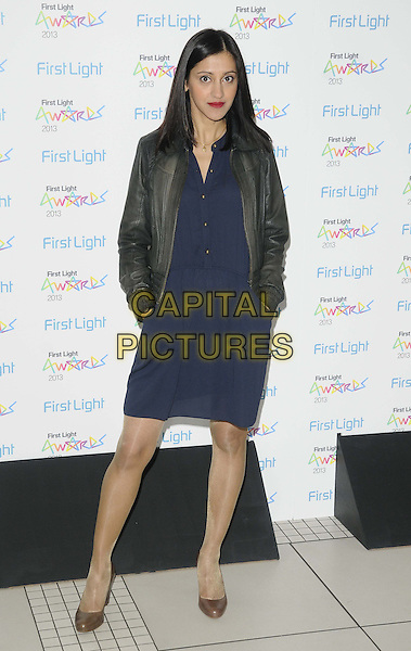 Manjinder Virk.attended the First Light Awards 2013, Odeon Leicester Square cinema, Leicester Square, London, England..March 19th, 2013.full length black leather jacket blue dress hands in pockets.CAP/CAN.©Can Nguyen/Capital Pictures.