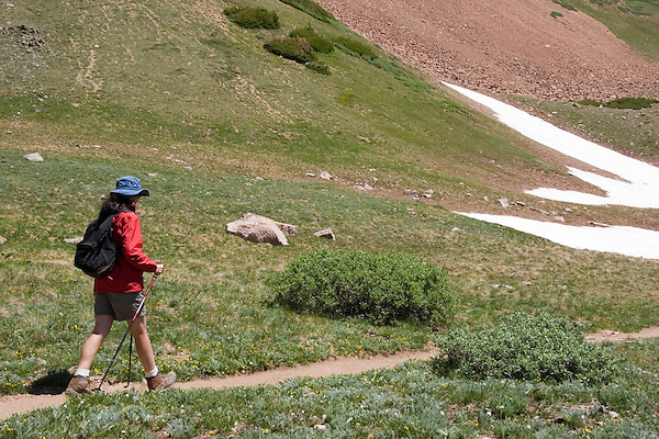Caucasian woman hiking in the James Peak Wilderness Area, Rocky Mountains near Georgetown, Colorado. .  John leads private photo tours in Boulder and throughout Colorado. Year-round.