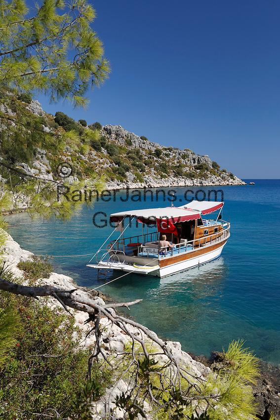 Turkey, Province Antalya, island Kekova, near Demre: Small Gulet boat in craggy cove | Tuerkei, Provinz Antalya, unbewohnte Insel Kekova bei Demre: Ausflugschiff (Gulet ) vor Anker